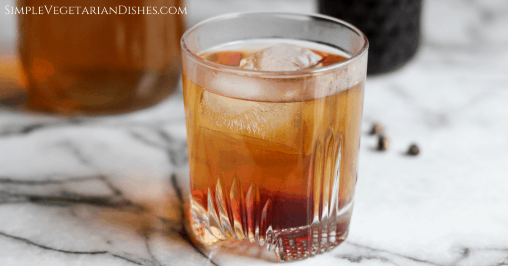 pomegranate green tea with ice in whiskey glass