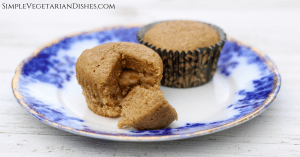 high altitude banana bread muffins with walnuts served on blue china on white board background