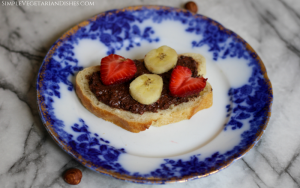 gianduja served on bread with strawberry and banana slices
