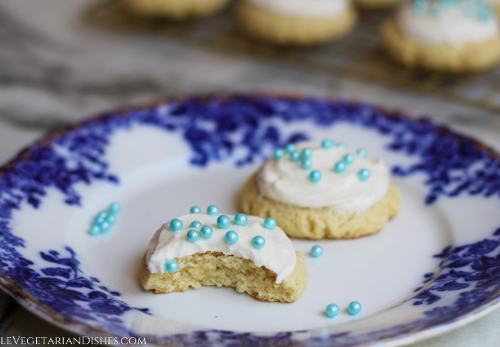 high altitude sugar cookies with bite taken on blue china plate