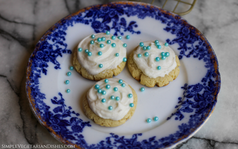 high altitude sugar cookies served on blue china with blue sugar pearls
